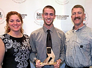Wyatt Cunningham accepting the award with his parents.